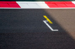 Starting block and red white border of track Royalty Free Stock Image