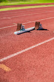 Starting block on a running track Royalty Free Stock Photos