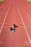 Starting block on a running track Stock Images