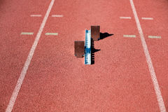 Starting block on a running track Royalty Free Stock Photo