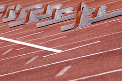 Starting blocks. Track start line view with shallow depth of field and focus on the first starting block stock image