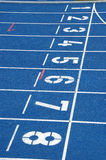Starting blocks. Of blue running track Stock Photography