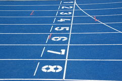 Starting blocks. Of blue running track Stock Images