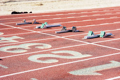 Starting Blocks. And lane markings at a college running track Stock Image