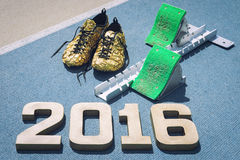 Starting Blocks 2016 with Gold Shoes Royalty Free Stock Images