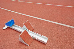 Starting blocks on race track Stock Photo