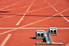 Starting blocks on running track Stock Photos