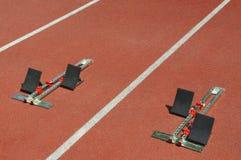 Starting blocks on running track Royalty Free Stock Photography