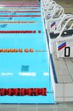 Starting blocks and swimming pool Royalty Free Stock Photo