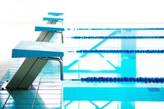 Starting blocks in a swimming pool Royalty Free Stock Photos