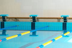 Starting blocks in a swimming pool Royalty Free Stock Photography