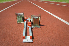 Starting blocks on tartan running track Stock Photography