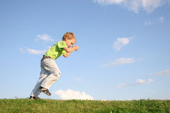 Starting boy on meadow Stock Photography