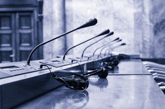 Starting a conference, microphones in the empty conference room. Royalty Free Stock Images