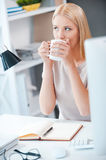 Starting day with cup of fresh coffee. Royalty Free Stock Image