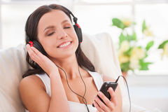 Starting day with her favorite music. Stock Image