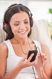 Starting day with her favorite music. Stock Photography