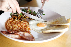 Starting the day with a tasty breakfast. Starting to eat a delicious home made breakfast Royalty Free Stock Photography