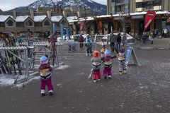 Starting early - young children skiers at Whistler Village royalty free stock photo
