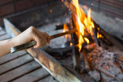 Starting Fire for Charcoal Grill. Arm With Long-Handled Tongs Se Royalty Free Stock Photos