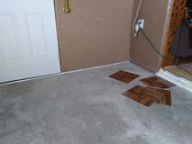 Starting a floor. Starting to lay tiles on concrete floor Royalty Free Stock Photo