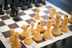 Starting game of old chess. Starting game of chess on the chessboard. Old chess pieces stock photo