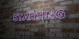 STARTING - Glowing Neon Sign on stonework wall - 3D rendered royalty free stock illustration Stock Photo