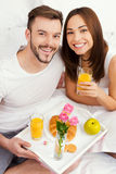 Starting a good day with breakfast in bed. Royalty Free Stock Image