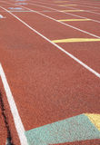 Starting Grid. On red running track Stock Photography