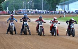Starting grid. Bikers wait in the starting grid at the pro motorcycle racing event on the dirt oval flat track speedway, Ashland County, Ohio, USA royalty free stock photography