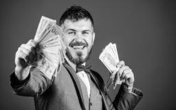 Starting his own business. Rich businessman with us dollars banknotes. Bearded man holding cash money. Making money with. His own business. Currency broker with stock photo