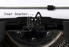 Starting a letter. Close-up of the words Dear Reader written with old typewriter Royalty Free Stock Photo