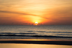 Starting Life. First light from sunrise at the sea Royalty Free Stock Image