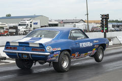 Drag racing. Napierville dragway july 12, 2014 rear side view of chevrolet camaro drag car starting at the lights during nhra national open event Stock Photos
