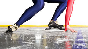Starting line. Speed skater at the starting line on an indoor ice rink royalty free stock images