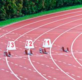 Starting Line. Lanes one through 3 equiped with starting blocks for the 100m dash stock photo