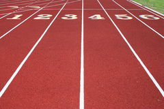 The Starting Line. The numbered lanes of a running tack Royalty Free Stock Photography