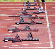Starting machineries on the running track. In a row Royalty Free Stock Images