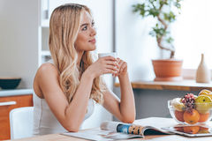 Starting new day with fresh coffee. Royalty Free Stock Images