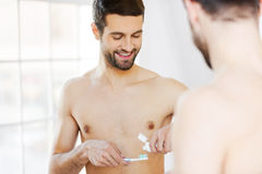 Starting new day with teeth brushing. Stock Photos