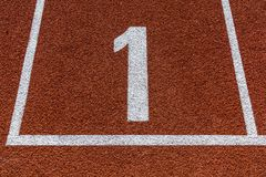 Number one on athletics all weather running track. Stock Photo
