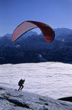 Starting paraglider. Above clouds, in the background the hills and mountains of Bernese highlands royalty free stock photography