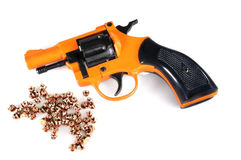 Starting Pistol and Blanks. Orange starter pistol and blank caps, isolated on white Royalty Free Stock Photos