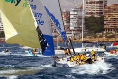 Sailboat Volvo Ocean 65 Team Clean Seas. Starting race in Alicante bay in Spain during the course around the world Volvo Ocean Race 2017-18 Royalty Free Stock Images
