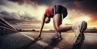 Starting runner. Sports background. Starting runner on road stock photos