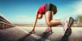 Starting runner. Sports background. Starting runner on road royalty free stock photo