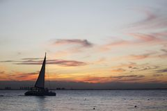 Sailboat crossing the sea at afternoon royalty free stock images