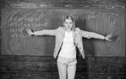 Starting to learn more. teacher on school lesson at blackboard. woman in classroom. School. Home schooling. serious royalty free stock photography