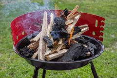 Starting up barbecue fire Royalty Free Stock Image