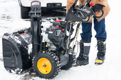 Starting up the snow blower Royalty Free Stock Photos